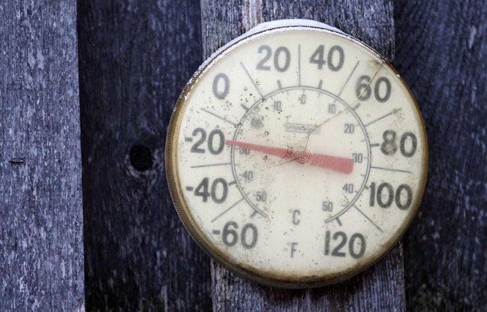 A backyard thermometer shows the temperature during winter in south Minneapolis